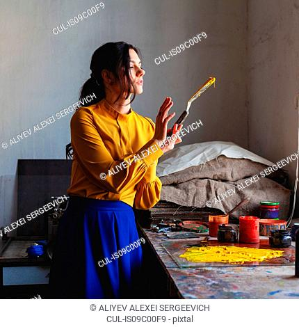 Woman creating art with scraper