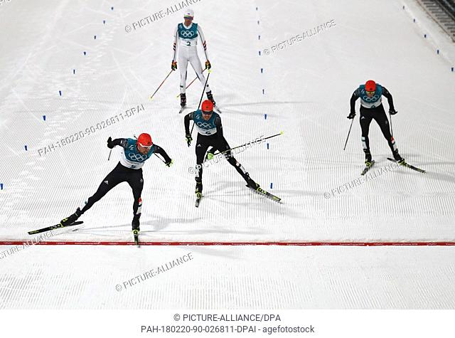 20 February 2018, South Korea, Pyeongchang, Olympics, Nordic combined, cross-country skiing, Alpensia Ski Jump Centre: Winner Johannes Rydzek (gold front)