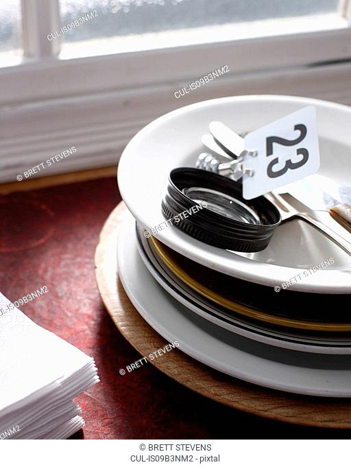 Plates stacked in restaurant kitchen, close-up