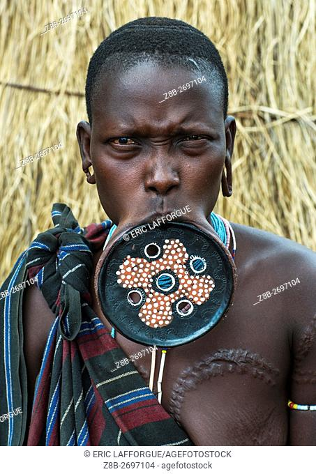 Ethiopia, Omo Valley, Mago park, a mursi tribeswoman wearing a traditional lip-plate