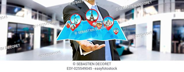 Businessman with digital map and pins floating over his hand