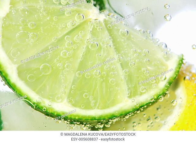 Close-up of lime in drink