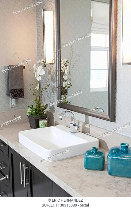 Sink and mirror in average bathroom