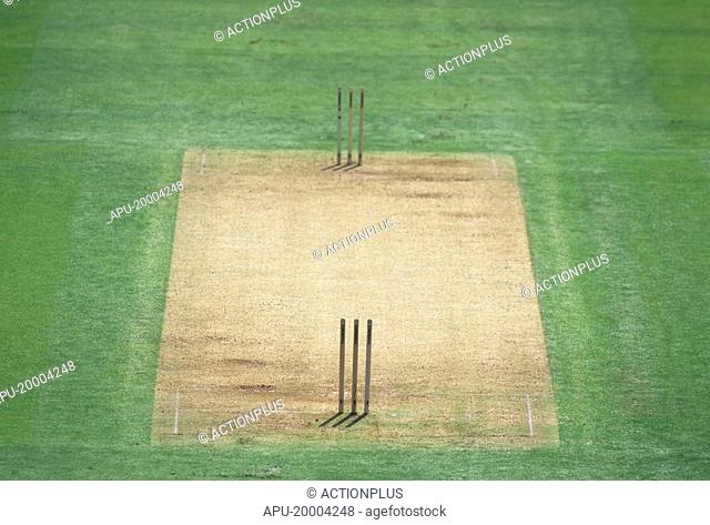 Two sets of stumps on a cricket pitch
