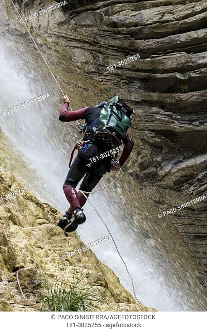 Climber descending a ravine. Pyrenees, Jaca, Spain