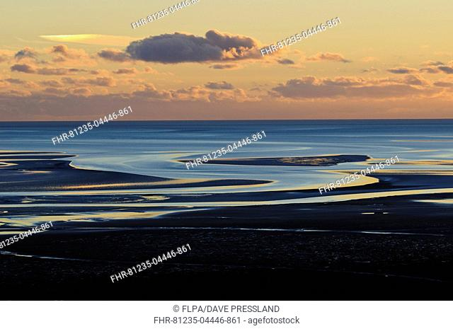 View across bay with channels in sand, at low tide in evening light, Humphrey Head, Morecambe Bay, Cumbria, England, December