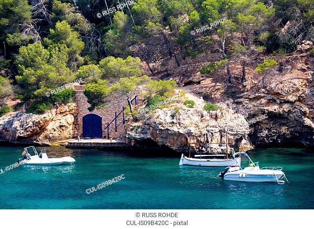 Motor boats moored off coast, Cala Figuera, Majorca bay, Spain