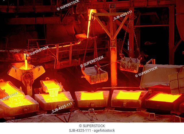 Copper Ingots Being Poured