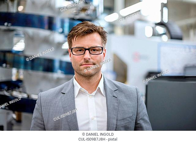 Portrait of male manager in factory