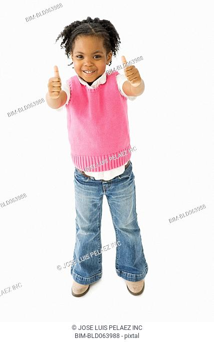 African girl making thumbs up gesture