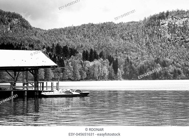 Wooden roof for trip holiday paddle boats. Holiday resort on the shores of beautiful Alpine lake