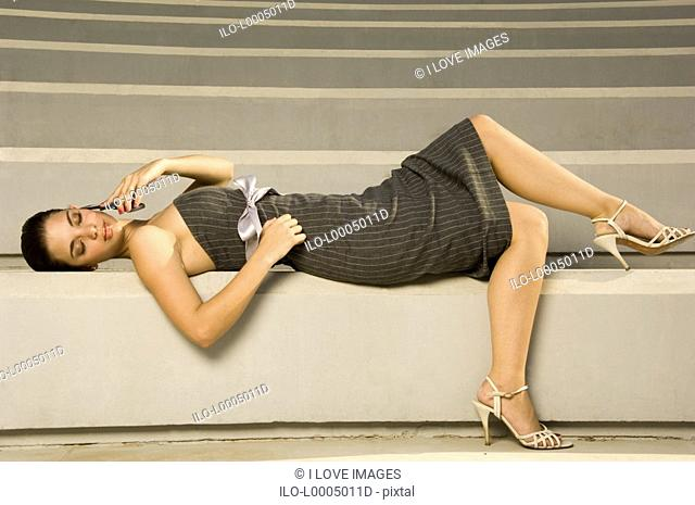 A young woman laying on some steps