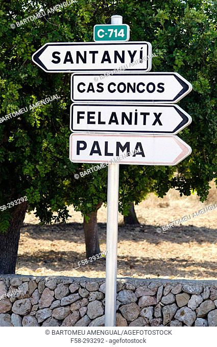 Road sign and drystone wall. Majorca. Balearic Islands. Spain