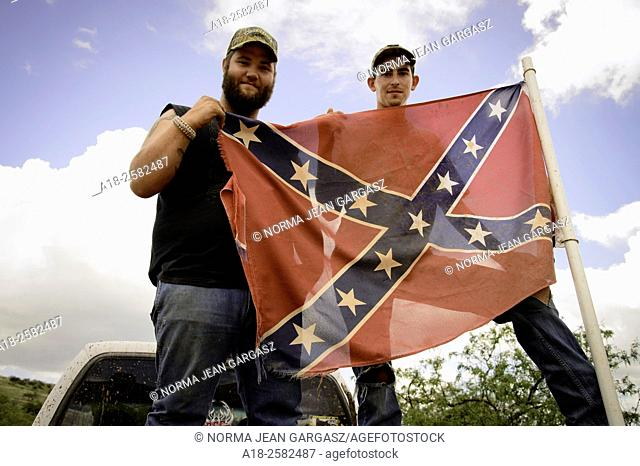 Sonoita, Arizona, USA, 7th July, 2015: Caleb Gates, 20, (left), and Ray Helton, 22, display the Confederate flag attached to the truck that Gates was driving in...