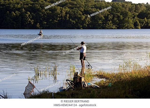 France, Nievre, Lake Pannecière, angling in the evening