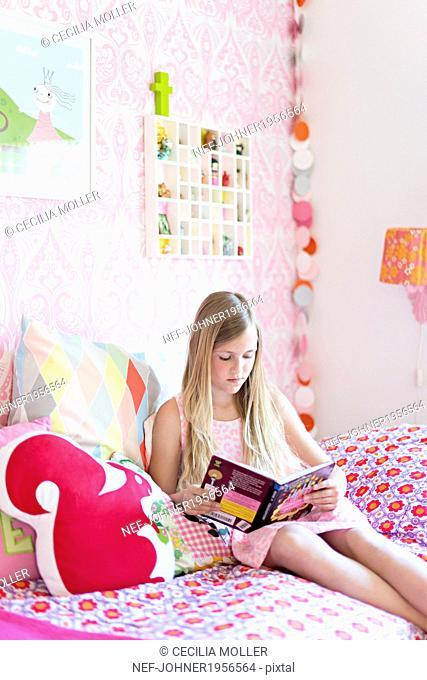 Girl reading in her room