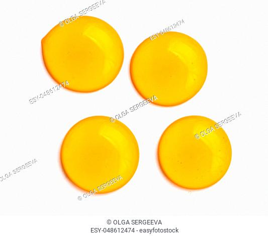 Honey drops. Honey for design elements. Abstract pattern from honey drops. Isolated on white with clipping path. Can use for design or text
