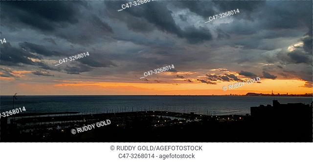 Stormy sky at sunset in El Masnou, Maresme area, Barcelona, Spain