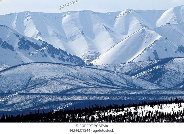 Winter scene of the Ogilvie Mountains along the Dempster Highway, Yukon, Canada