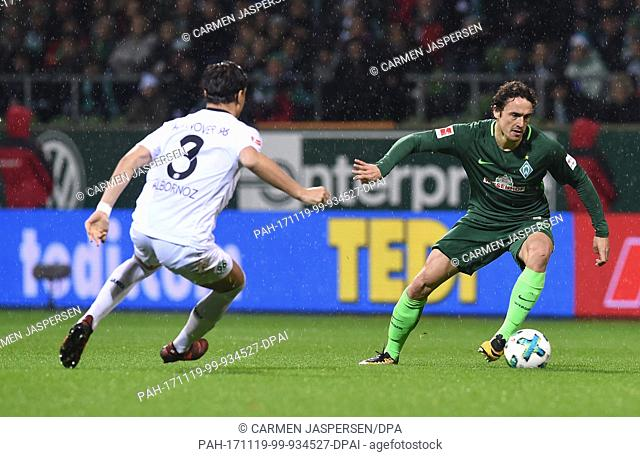 Bremen's Thomas Delaney (R) and Hanover's Miiko Albornoz vie for the ball during the German Bundesliga soccer match between Werder Bremen and Hanover 96 in the...