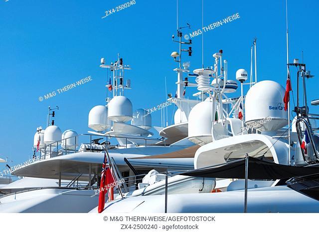 Luxurious motor yachts harboring in the marina of Saint-Tropez, Var, Provence Alpes Cote d'Azur region, France