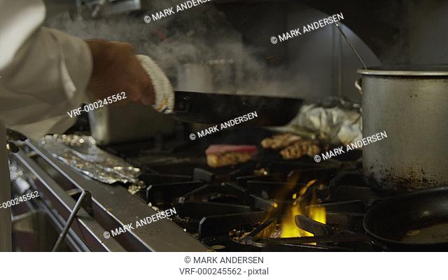 SLO MO MS Chef cooking on stove / Miami, Florida, USA