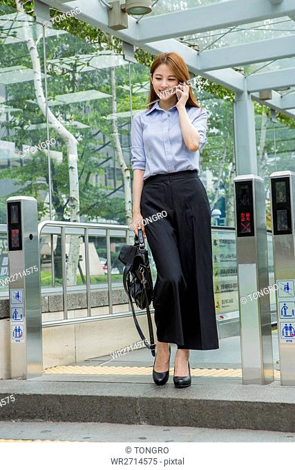 Smiling businesswoman talking on cellphone