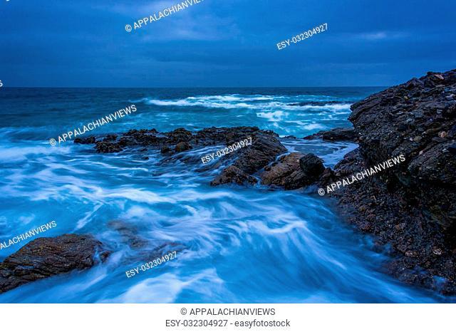 Waves and rocks in the Pacific Ocean at Table Rock Beach, in Laguna Beach, California