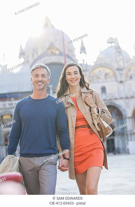 Portrait of smiling couple in St. Mark's Square in Venice