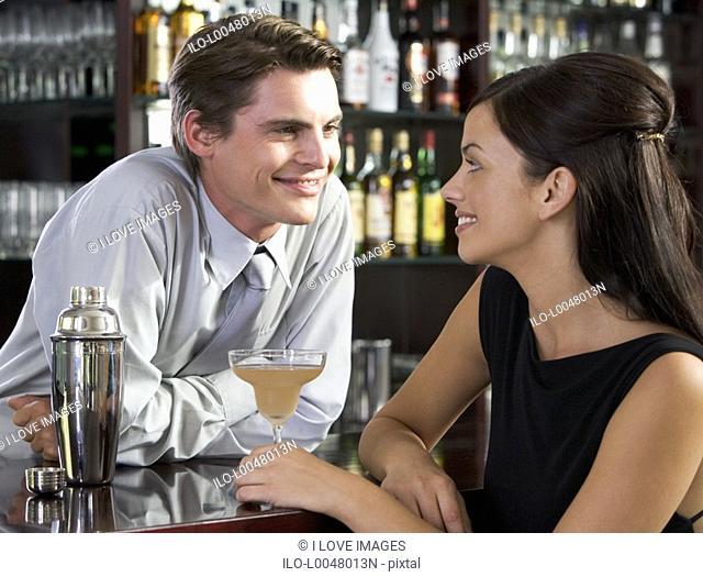 A barman flirting with a customer