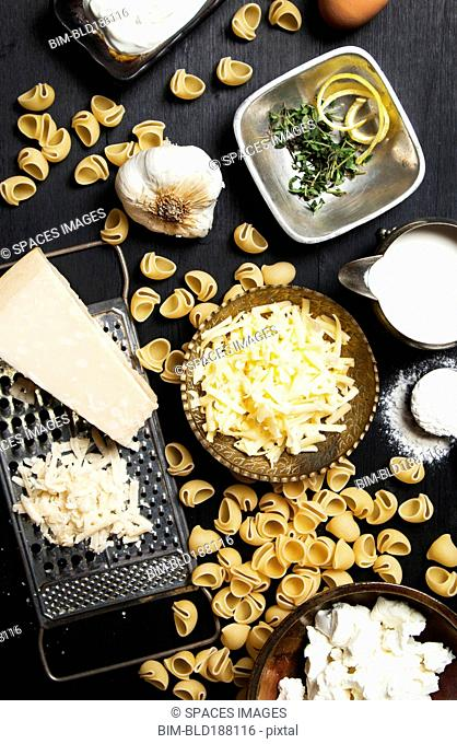High angle view of cheese and pasta ingredients