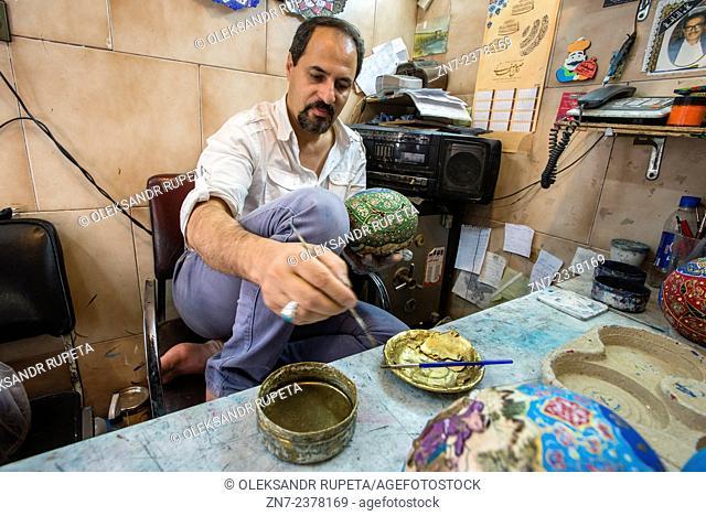 Artist Hassan Peykam paints ostrich's eggs, Esfahan, Iran