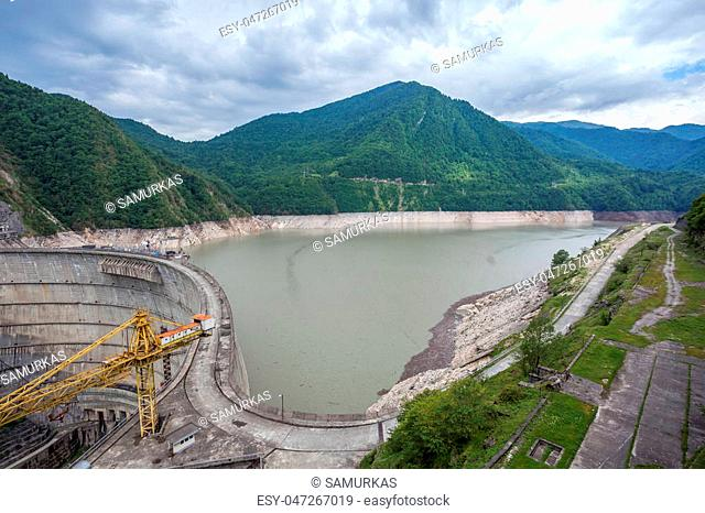 The Enguri hydroelectric power station HES. The Jvari Reservoir next to Inguri Dam, surrounded by mountains. Third highest concrete arch dam in the world