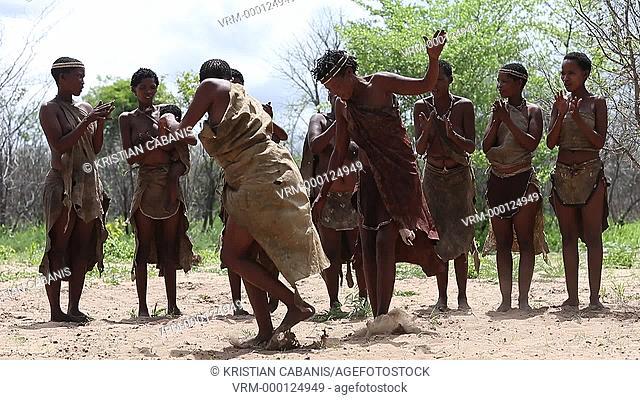Ju/'hoansi San Bushmen women dancing, Kalahari, Namibia, Africa