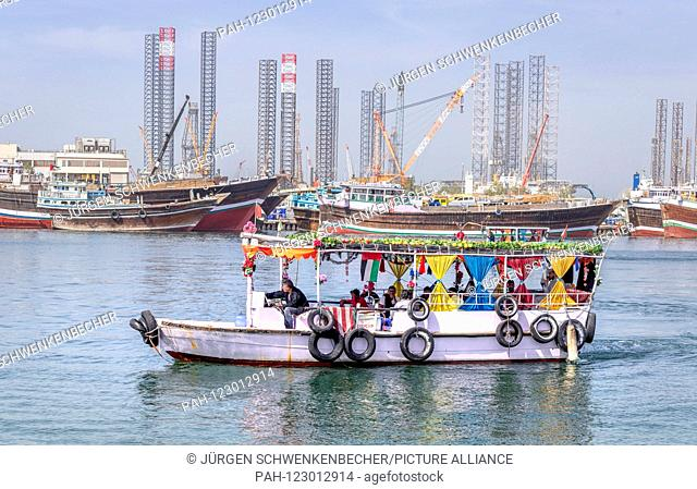 Colourfully decorated ferries head for various destinations on the Creek in Sharjah. The boats are an important means of transport for many Emiratis