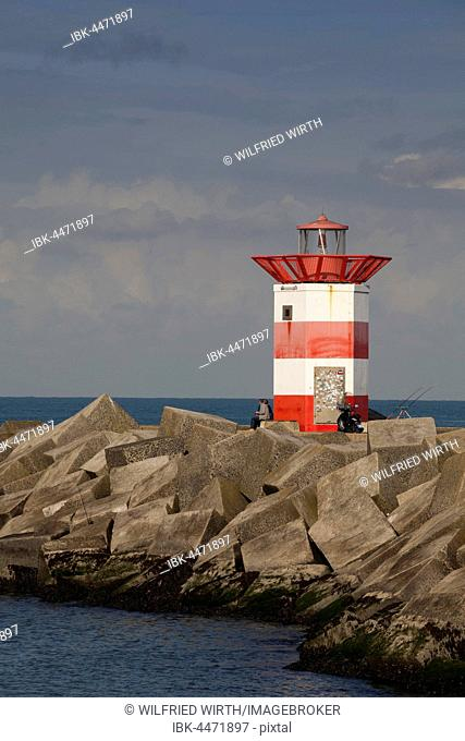Small lighthouse at harbor entrance, Scheveningen, The Hague, Holland, The Netherlands