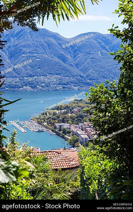 Switzerland, Ticino, Locarno, View of Lake Maggiore and Locarno boat harbour from Orselina