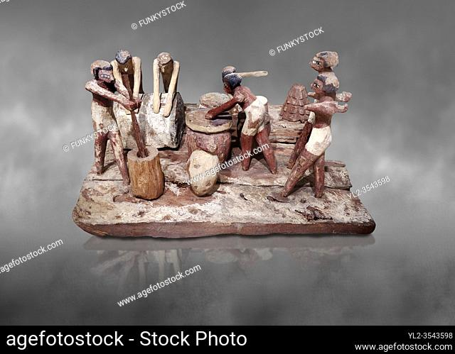 Ancient Egyptian wooden model of bread making, Middle Kingdom, (1939-1875 BC), Egyptian Museum, Turin. Grey background.