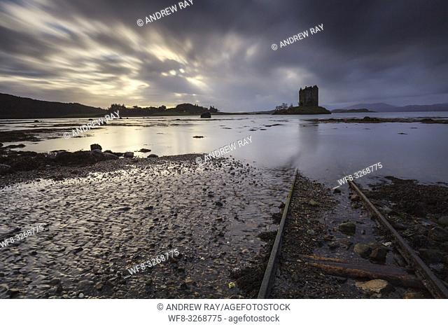 Rail tracks at Castle Stalker in the Scottish Highlands, captured from a low angle, on an afternoon in early November