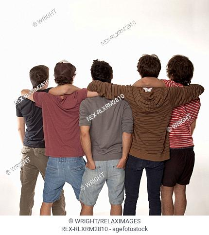 Five meeting teenagers rear view 5 boys standing