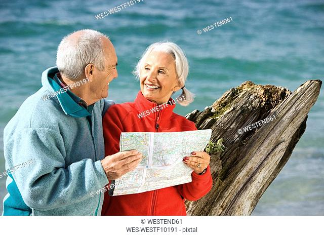 Germany, Bavaria, Walchensee, Senior couple looking at map