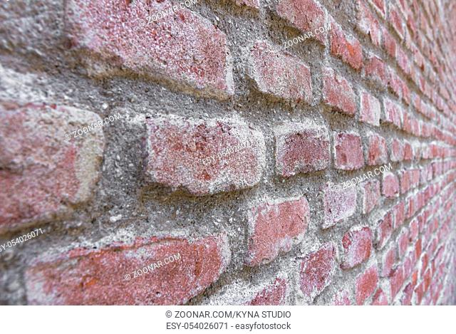 Abstract perspective of a red brick wall. POV left to right