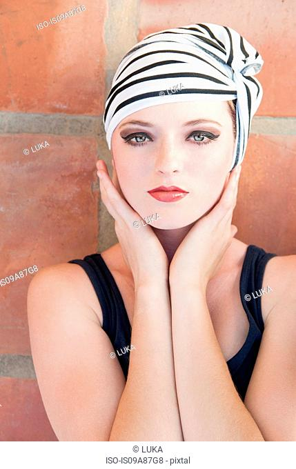 Girl wearing striped turban