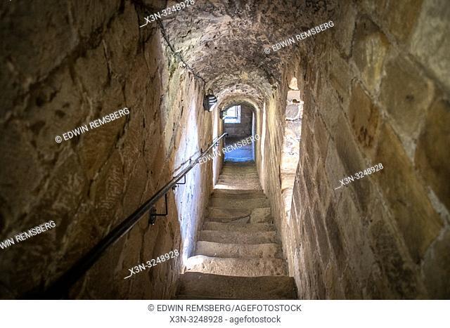 View down narrow enclosed stone staircase, Edinburgh, Scotland