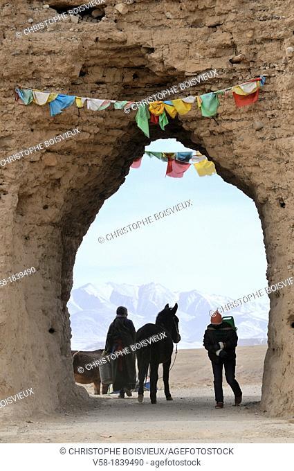 China, Gansu, Amdo, Xiahe county, Karnang Bajiao, 2000 years old city walls Han dynasty, Water chore