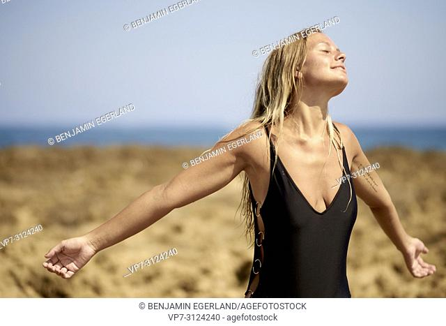 Woman at beach, sensual, daydream, getting away from it all, summer. Malia, Crete, Greece