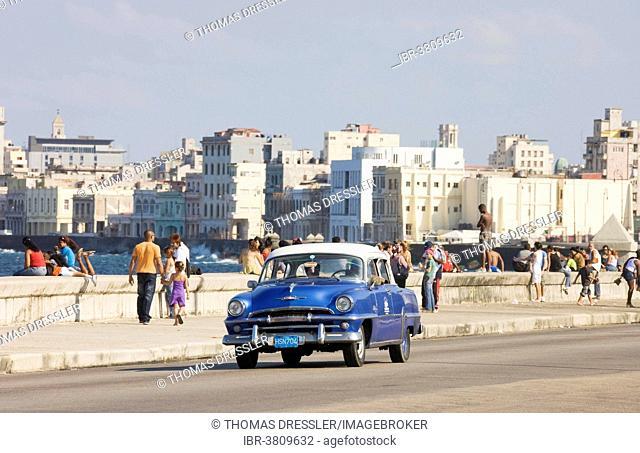 1954 Plymouth driving on the Malecón esplanade, classic car, Havana, Cuba