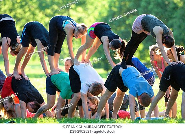 Group of Young Acrobatic People Exercising in Forming a Pyramid