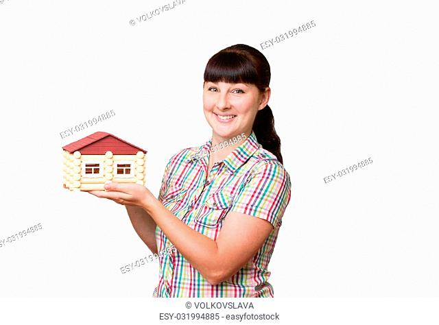 Young woman holding home isolated on a white background