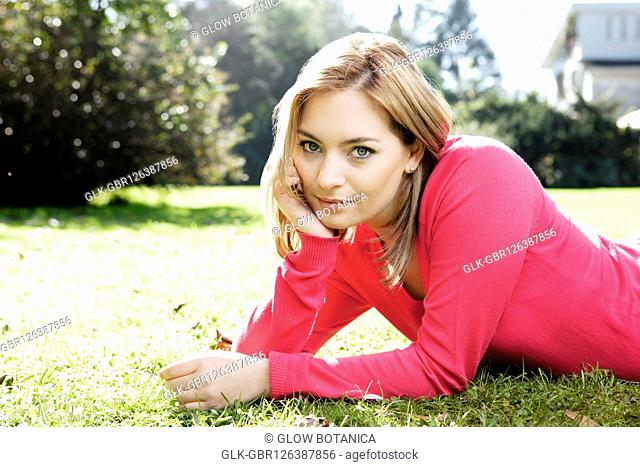 Woman lying in a park and smiling